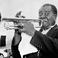 Image 6: Louis Armstrong playing instrument