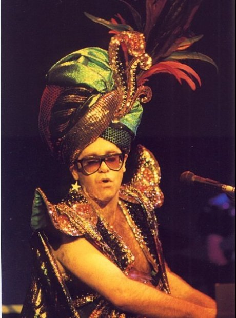 Elton John as Carmen Miranda