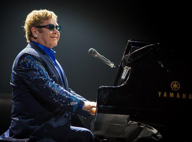 Elton John at his piano