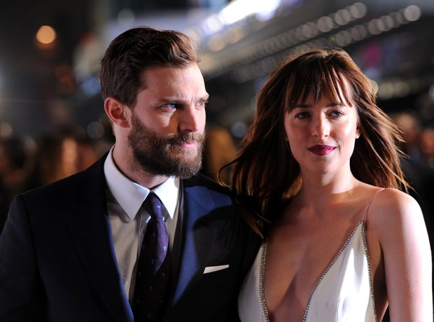 Jamie Dornan and Dakota Johnson on the grey carpet