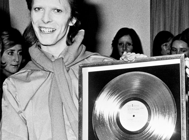 David Bowie holding a Gold Disc