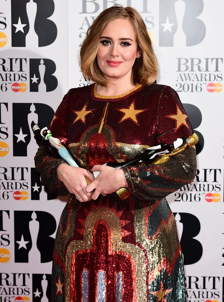 Adele with her awards The Brits 2016