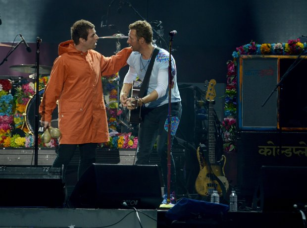 Liam Gallagher and Chris Martin live during One Lo