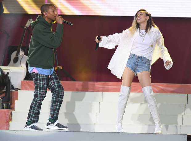 Pharrell Williams and Miley Cyrus live during One