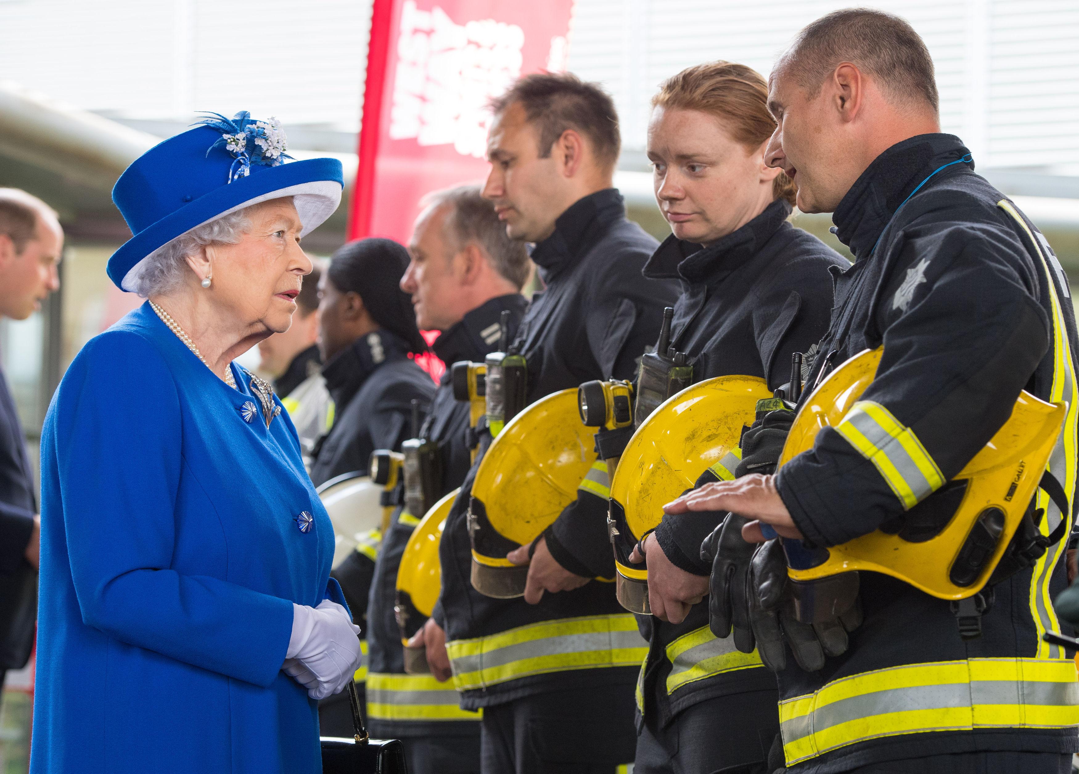 Queen Elizabeth II meets firefighters