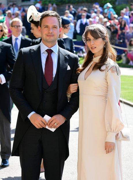 Patrick J. Adams and wife Troian Bellisario arrive