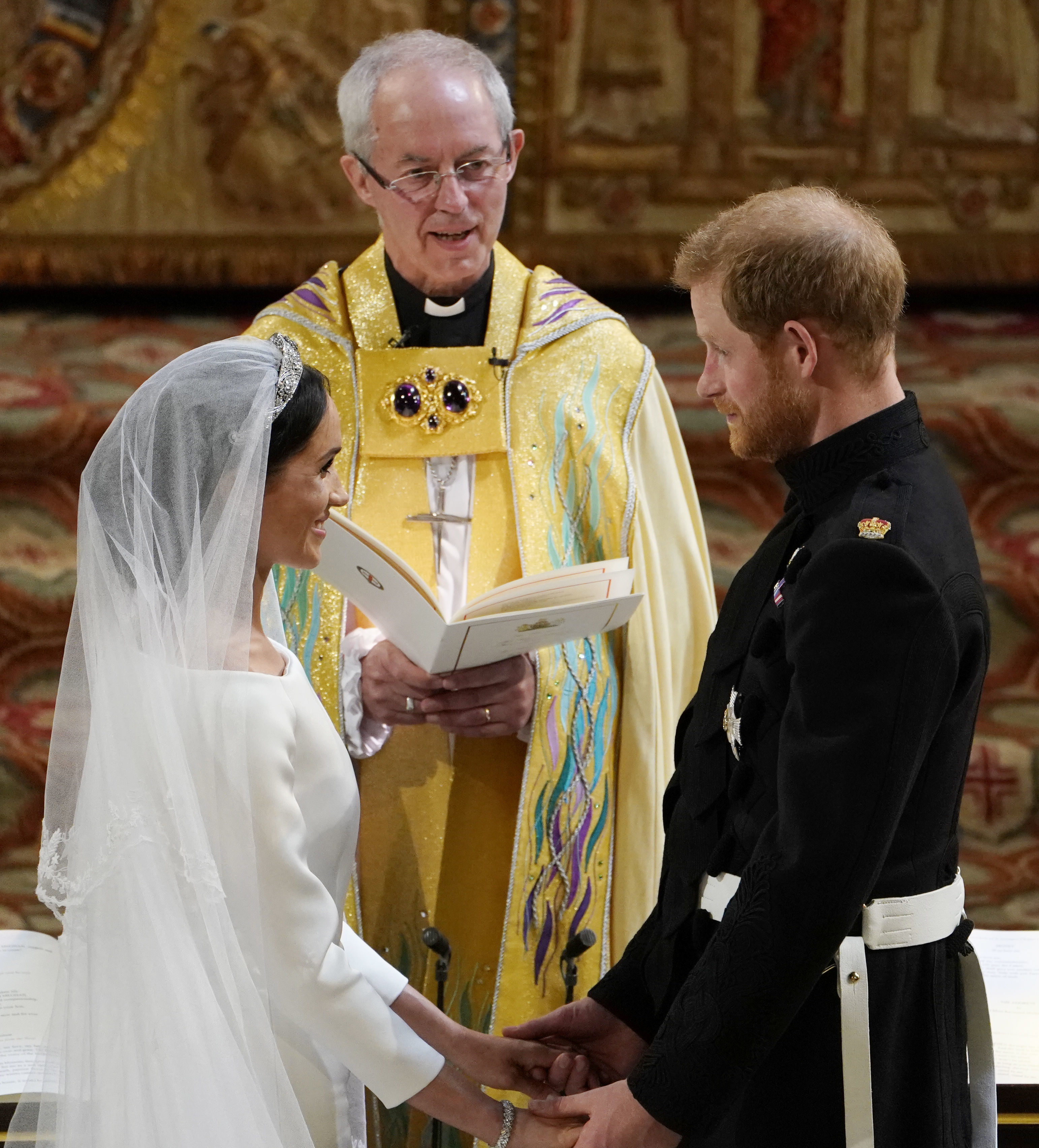 Prince Harry and Meghan Markle exchange vows