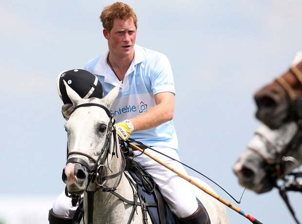 Prince Harry playing polo