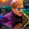 Image 7: Elton John performing on stage