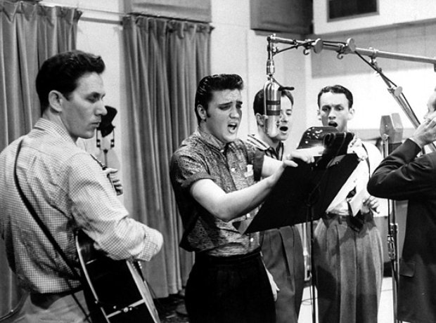 Elvis Presley with his backing singers