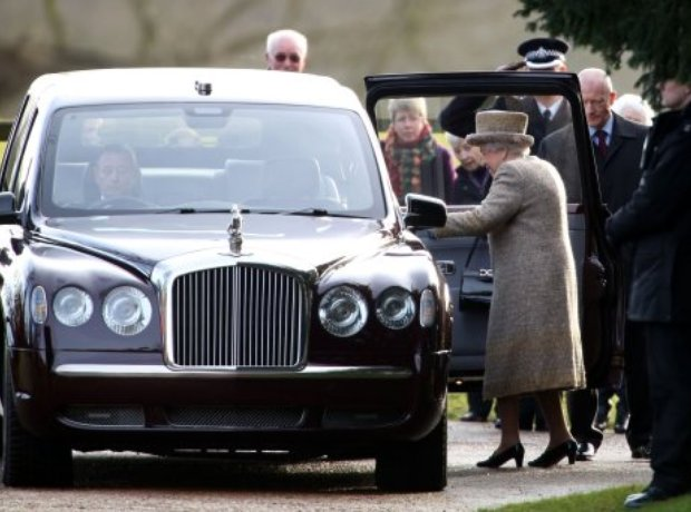 The Queen stepping into the Royal car