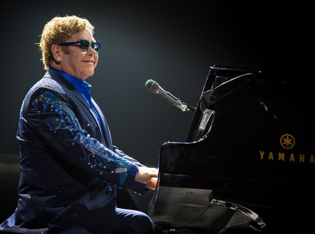 Elton John at his piano