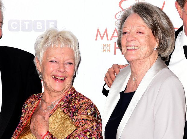 Dame Judi Dench and Dame Maggie Smith attend the p