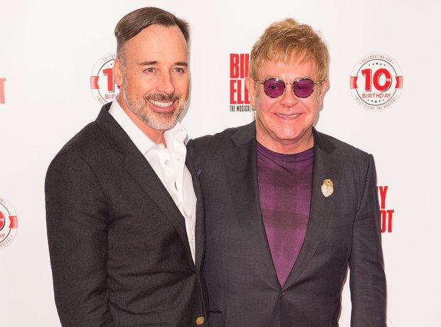 Sir Elton John and husband David Furnish attend th