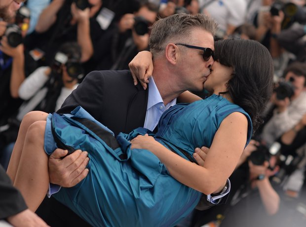 Alec Baldwin kisses wife Hilaria Thomas.