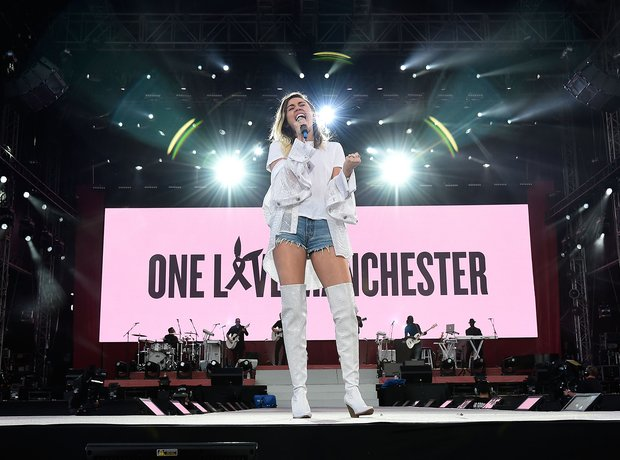 Miley Cyrus live during One Love Manchester