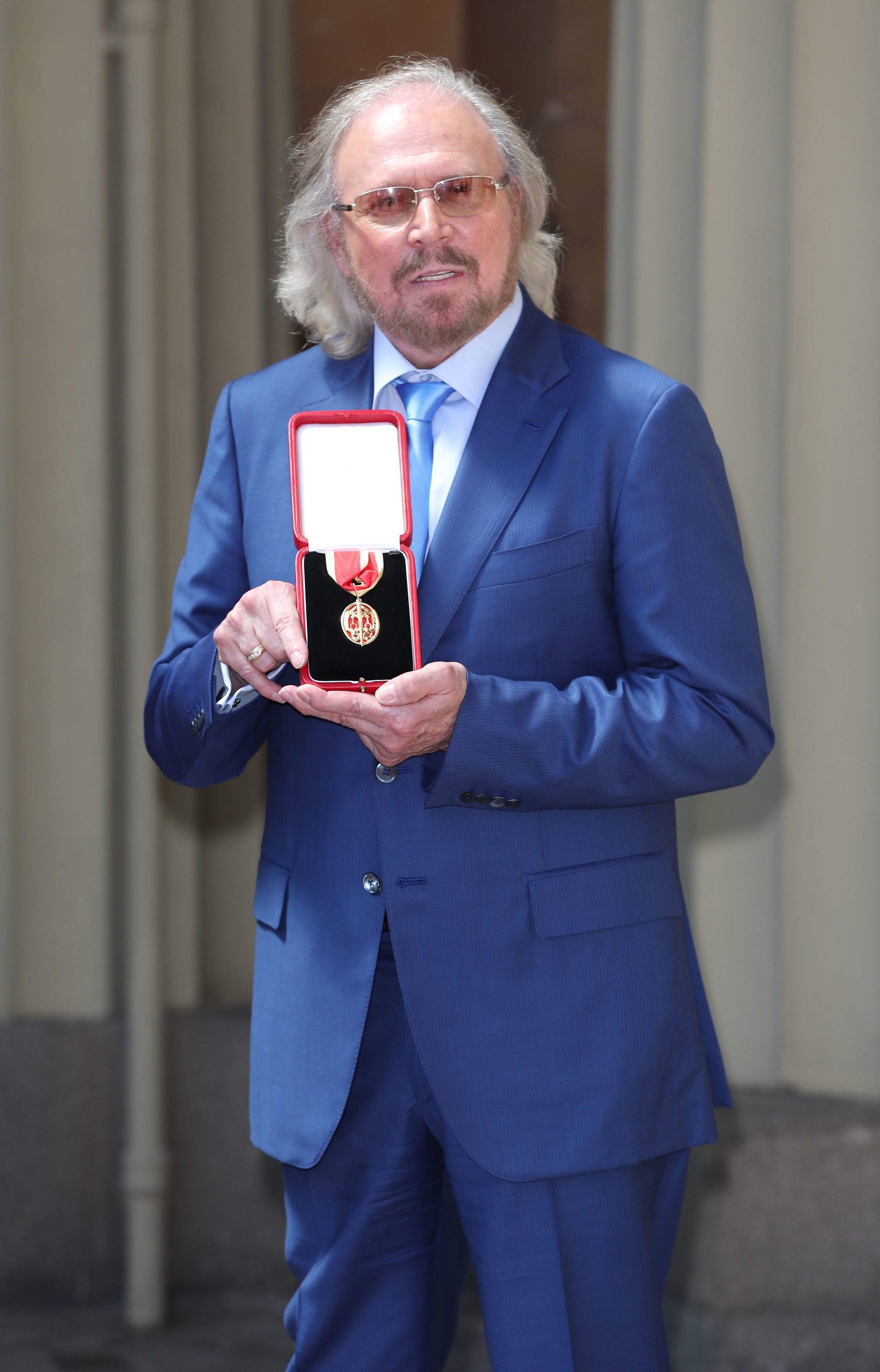 Barry Gibb receives his knighthood from Prince Cha